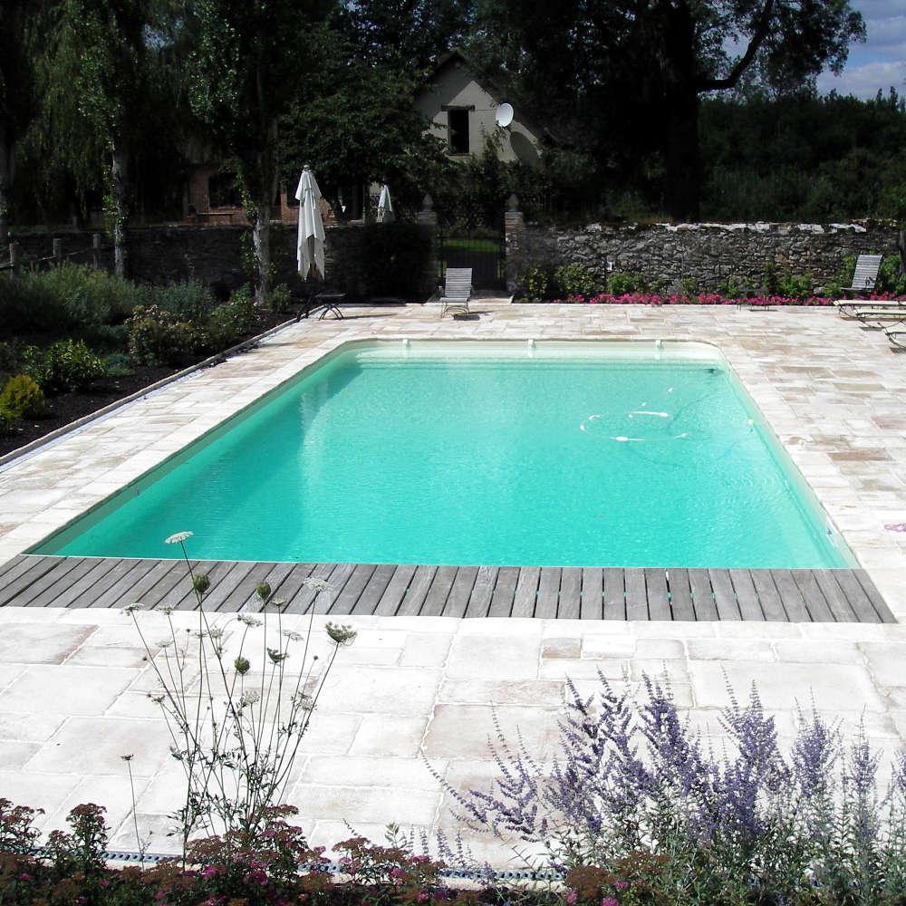 Votre concepteur euro piscine services with prix d une for Prix piscine caron
